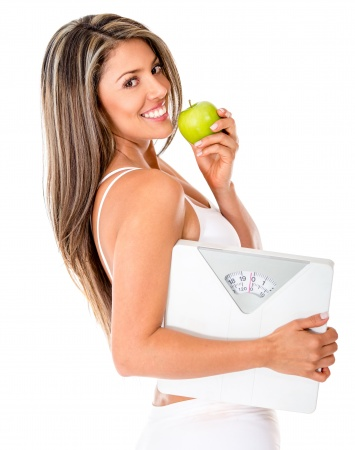 Healthy eating woman loosing weight - isolated over a white background